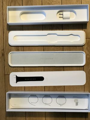 Apple Watch box with watch band and adapter