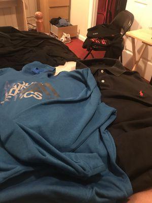 Blue Northface hoodie and black Ralph Lauren polo shirt