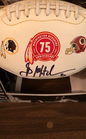 Autographed Washington Redskin Football by Redskins All Time All Purpose Yards Leader Brian Mitchell! Autograph in Black Sharpie!