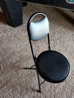 Black folding padded gaming chair