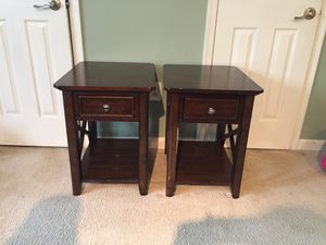 2 brown wooden end tables.