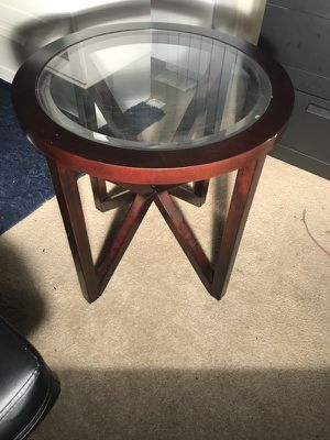 Round brown wooden frame glass top coffee table