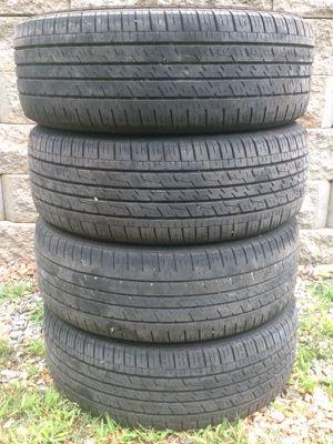 Four 225-60-R17 tires