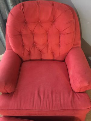 Red rocking armchair and ottoman