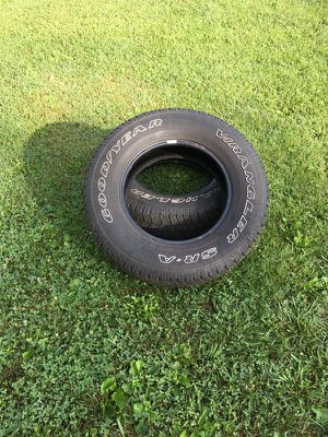 Two P235-70 R16 Goodyear Wrangler RS/A tires.
