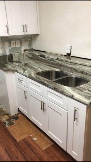 Granite and cabinet