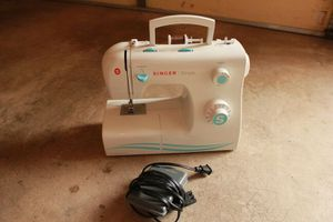 Singer 2263 Simple 23-Stitch Sewing Machine.