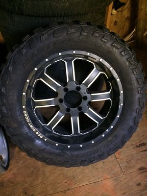 Three 20x9 6 lug red dirt road wheels, with 305-55-R20 wheels mounted on them
