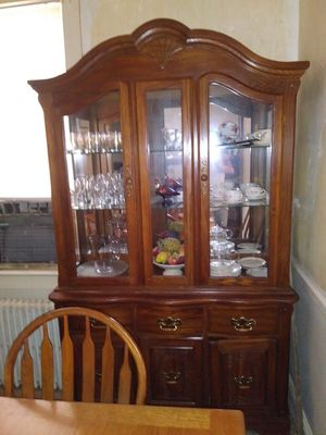 Dark Oak China cabinet lighted with mirrored back. No scratches. In very good shape.