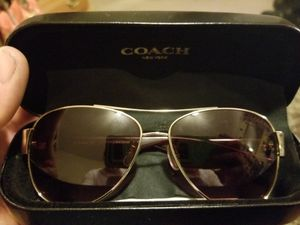 New Coach aviator sunglasses.