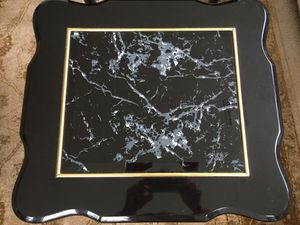 Two black and gold side tables