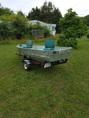V bottom boat with 5hp Johnson engine