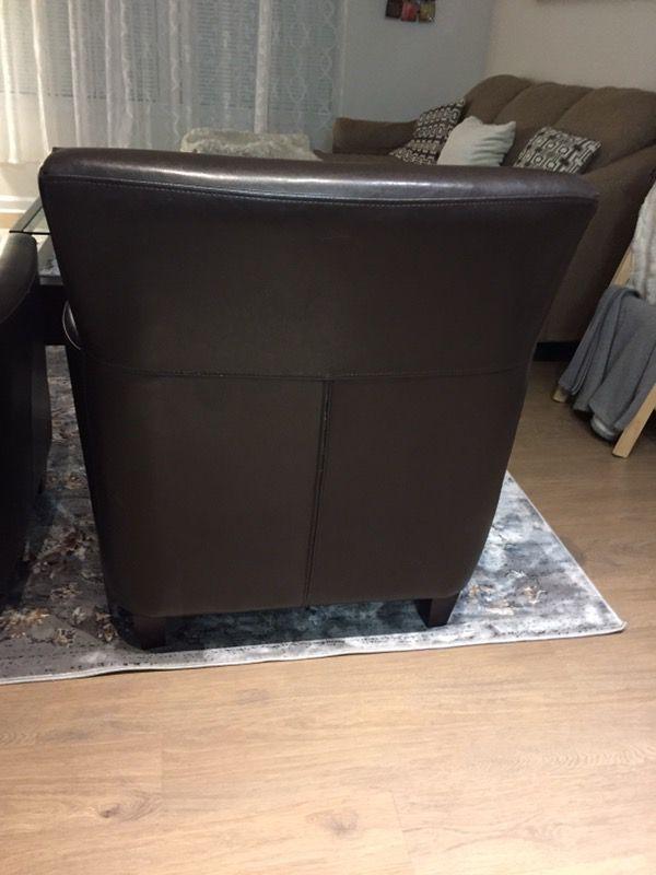 Two twin dark chocolate genuine leather sofa chairs