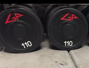 Up for grabs...CHEAP PRICE!! Pair of 110s lbs GP Urethane Commercial dumbbells.