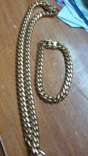 Very nice 14kt gold over stainless steel 12mm by 26onch long Miami Cuban link Chain for sale !