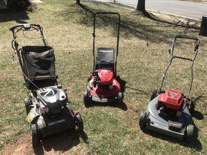 3 lawn mowers
