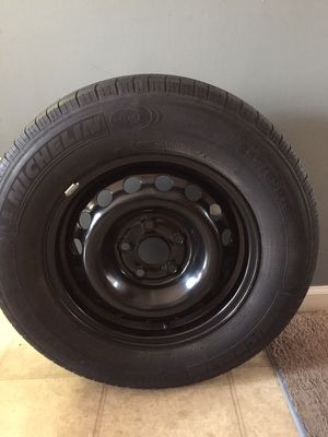 Rim and tire for sale. Tire size 234/65/R16. Brand new rims. Bought to have a spare for our van which was traded shortly after.