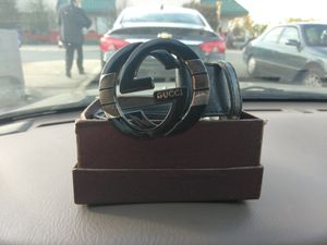 Black and gold Gucci belt