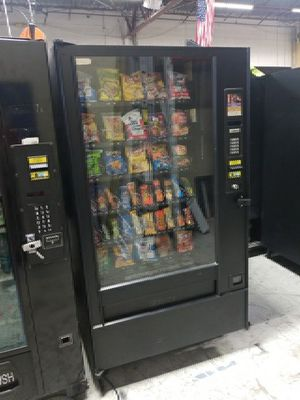 Golden eye snack vending machine fully working
