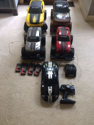 Lot of 5 RC monster trucks and car