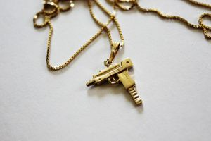 Brand New Gold Supreme Gun Chain