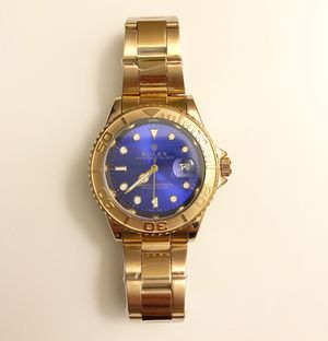 Color Gold / Blue Watch. Perfect copy. New, never used. Men's or Women's. **ASAP $150 Please do not waste my time with low offers.