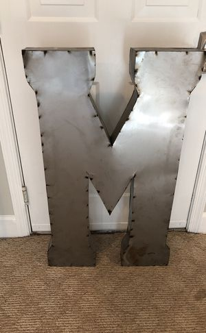 Large metal M sign