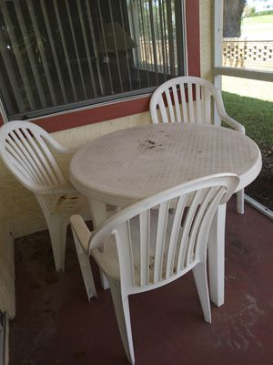 Plastic table with 4 chairs