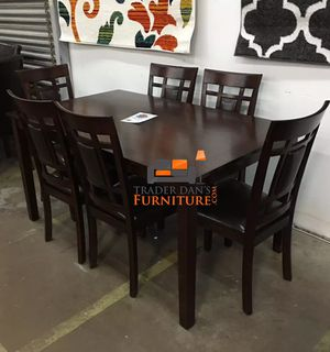 Brand new wooden dining table and 6 chairs (firm price)