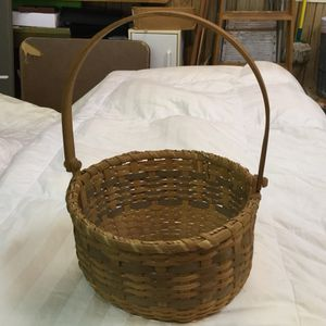 "Basket with handle, approximately 12"" in diameter"