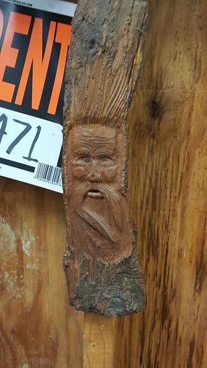 Wood carvings of old men