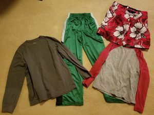 2 long sleeve tee shirts 1 swimming trunk 1 jogging pants Preowned