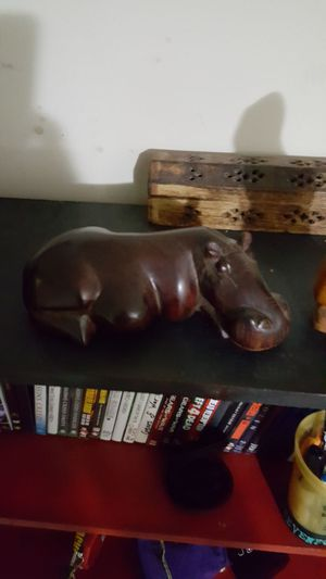Carved wooden Eskimo and carved hippo