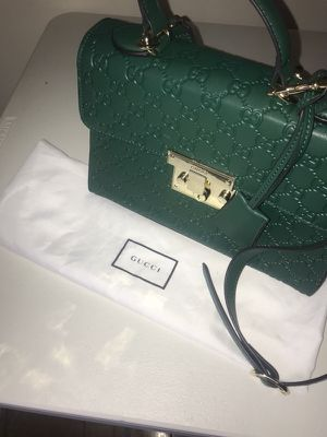 Authentic signature GUCCI padlock shoulder bag. In LIMITED green color