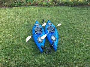 2 Kayaks by Equinox, lifejackets and carriers