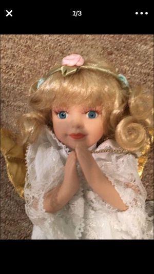 Porcelain praying angel doll on her knees
