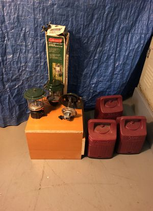 3 Coleman camping lanterns and 2 distribution trees