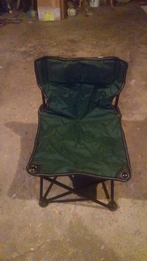 Child's folding chair with bag never used