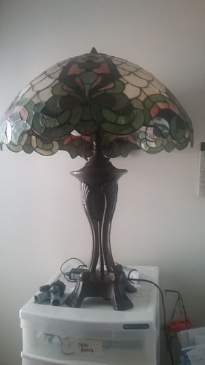 "Tiffany like lamps. 24""tall. 20""wide. Weight about 12#each."