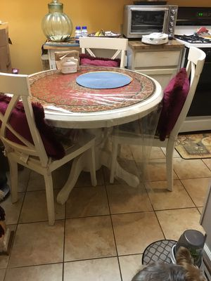 Round table and four chairs