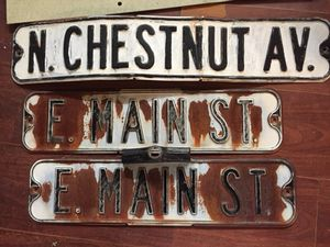 3 old metal street signs with Raised letters and the topper