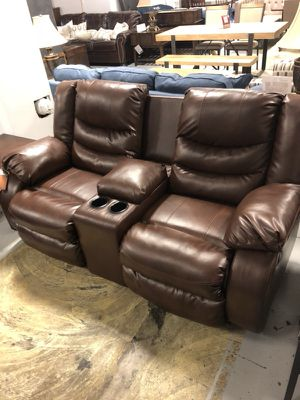 Ashley Leather reclining love seat with console