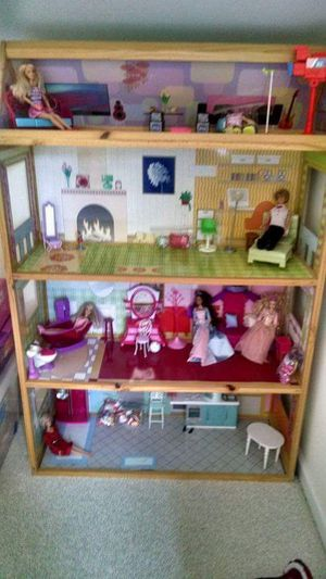 Barbie style dollhouse, barbies, ken, tent, and convertible car with accessories