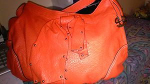Orange leather purse. Used but very clean inside and out.