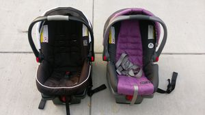 Two Graco baby car seats