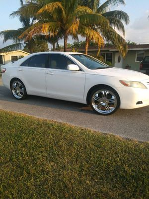 2008 camry,145k miles,cold ac,pwr windows & seats, sun roof. 20 inch rims,Rebuilt title (%100 Good Car )$3500 firm.No hurry to sale