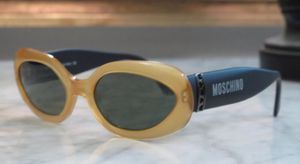 Moschino Women Oval Style Sunglasses black/yellow