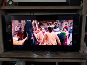 Sony 4K TV with side speakers.