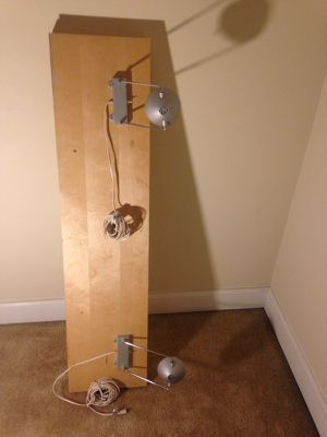 Wall mount that has extendable lights (2) with foreign plugs