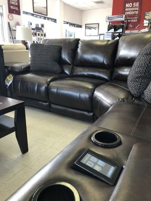 Leather power reclining sectional with luxurious features